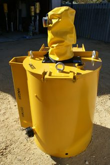 Yellow Steel Mixing Bowl with cover over the top of the pumps section